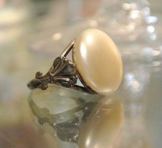Hey, I found this really awesome Etsy listing at https://www.etsy.com/listing/246268351/antique-ring-faux-pearl-art-nouveau