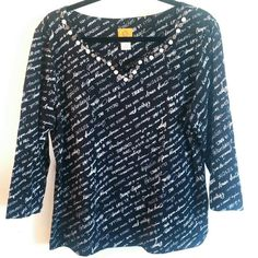 Ruby Rd French Words/Fonts Black & White Top XL This Ruby Rd Black & White French Words/Fonts Top is a size XL in great used condition. Tres amusant! Oui? It has a super fun print with French words in various fonts, has shell buttons embellishing the neckline, and has some stretch. Le classique! Bust measures 22 inches across laying flat, measured from pit to pit. 25.5 inches long. ::: Bundle 3+ items from my closet and save 30% off when you use the app's Bundle feature! ::: No trades. Ruby…