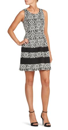 This fabulous dress is a geometrical masterpiece! The bold pattern is perfectly displayed in black and white. The killer fit compliments your physique, highlighting all of your finest assets. This statement piece is sure to be a conversation starter so put it on and get ready to mingle!  Fits true to size Sleeveless dress. Decorative zipper at back. Round neck. Pleats from waist and down. Length: 90 cm in size M. 57% Cotton, 32% Polyester, 11% Elastane Brand: ONLY