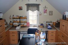 Scrapbook Studio, Maple cabinetry and maple Longaberger baskets and wrought iron turn my 12 x 13 foot space over the garage into a cozy scrapbook studio.  I recently tweaked my room and you can see the whole tour here:  http://snapsandsnippets.blogspot.com/2013/02/studio-re-deux-finale-or-would-that-be.html, A look straight into my room.     , Other Spaces Design