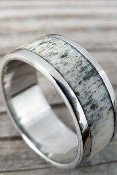 Mens deer antler wedding ring. I love these deer antler rings... they are just so unique. Plus you can customize this ring however you want.