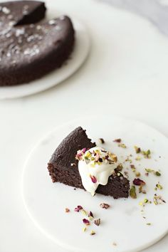 Dark Chocolate Olive Oil Cake pistachio, rose, cardamom cream, cyprus salt Serves 8 — This beautiful and simple chocolate cake embodies a balance of sweet and savory.We love using a rich extra-virgin olive oil and a great-quality chocolate for the utmost avor. Top this cake with any