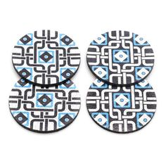 A perfect Moroccan touch to your tabletop, this set of 4 coasters features a Moroccan inspired pattern in blue and white. This unique set of 4 coasters is made from 100% recycled rubber and won't slip or scratch your surfaces. Made in the USA.