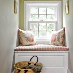 A cozy second-floor window seat makes a quiet retreat.