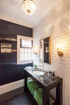 Contemporary bathroom features an accent wall clad in white subway tiles lined with a dark stained ...