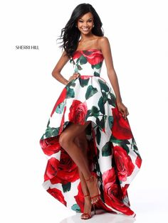 This Sherri Hill 51816 rose print strapless formal dress features a straight across neckline, over a pleated high-low skirt that flows to a slight sweep train. Available in sizes 00 to 18.