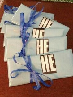 "Hershey baby shower chocolate bar. Gender reveal. Use pink paper and reveal the ""her"" or the ""she"", or use blue paper and reveal the ""he"". Cute and clever."