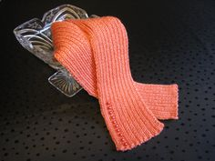coral knitted ribbed scarf with button detail