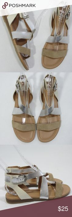 "Franco Sarto Glorious Silver Gladiator Sandal *S37 Stylish wide-band gladiator sandal by Franco Sarto. [Size 7.5M/37.5 Heel to toe approx 9.5"" Heel 0.75""] Mostly man made with real suede detail. Tan, white, and silver. Excellent gently worn condition, no flaws-like new.   // No holds, trades, or modeling. Colors may vary on screen. Please use measurements. Offers welcome.   *Last characters in title is inventory number. Franco Sarto Shoes Sandals"