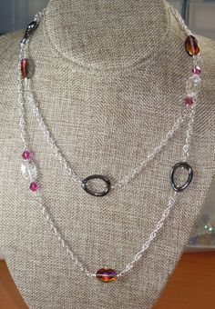 A personal favorite from my Etsy shop https://www.etsy.com/listing/264126244/swarovski-beaded-long-chain-necklace