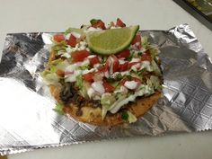 New! Tostadas. Fried corn tortilla piled high with all the fixins!