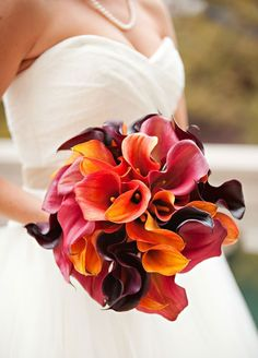 An assortment of calla lilies in earthy hues is the perfect accessory for an autumn bride's walk down the aisle. Wedding Bouquets, Floral Arrangements, Fall Flower