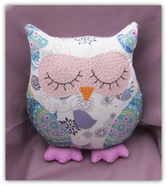 Songbird is a snoozy owl cushion, standing 35cm tall on her plump, polka dot feet.  The background fabric used on Songbird is a delicate, whimsical design by Alexander Henry, and the sleepy eyes are hand appliqued.