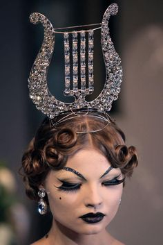 Fun Fact: my family symbol is the lyre. So I should probably wear this John Galliano to all family holiday parties.