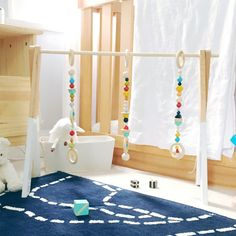 Designed to provide a feeling for the aesthetics of shape and color. Wooden gyms are made with a timeless style that can go beyond the nursery. Quality craftsmanship, eco-friendly materials and functionality provide the foundation for our handmade wooden toy collection. This handcrafted activity gyms are made with great care and lots of love and use natural beech wood beads and non-toxic water based paints with absolutely no VOCs.