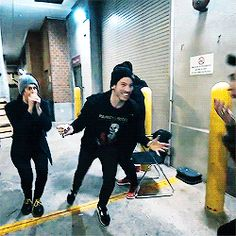 tyler joseph // josh dun // twenty one pilots // friends! Lol. Brendon was trying to balance one of those spinner toys on his finger and was successful. Josh was very happy for him.
