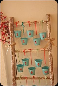 Make an advent calendar out of an old ladder and buckets. The Mirror And The Drape: Confessions of a Design-a-Holic