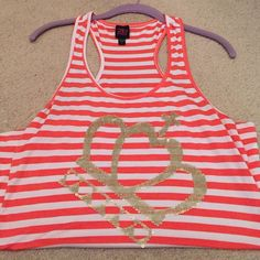 Tank top Orange and white stripped tank top with sequin detail. Never worn but no tags. bebe Tops Tank Tops