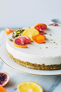 Made with greek yogurt, coconut, blood oranges, vanilla, a date-sweetened pistachio crust and topped with fresh citrus and cardamom candied pistachios.