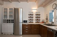 TRAMOUNTANA VILLA, SANTORINI. Adjacent to the dining room is a fully-equipped kitchen.