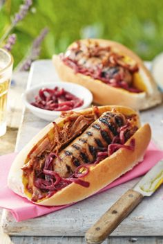 Serve up these crowd-pleasing hot dogs at your next barbecue blowout. These delicious dogs are topped with mouthwatering pulled pork and a sticky red onion relish that's sure to go down a storm. Hot Dog Recipes, Barbecue Recipes, Sausage Recipes, Pork Recipes, Party Food Hot Dogs, Bonfire Night Food, Sandwiches, Bbq Accessories, Tesco Real Food