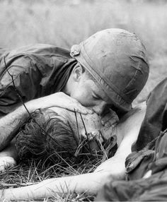 Medic James Callahan looks up after trying to resuscitate a dying soldier northeast of Saigon, 1967.   Henri Huet