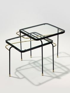 Mathieu MATEGOT . Series of two nest tables, 1956. Black enamelled metal and brass