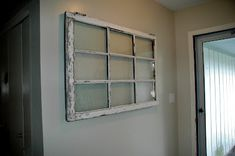 Cheap and easy way to hang a heavy window, photo or frame on your wall. Just did it and love the flush look and no wires!