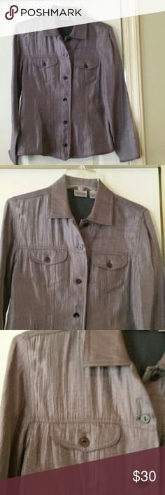 Chico's Shiny Dark Silver Button Down Blouse Small Pretty, shiny dark silver button down blouse by Chico's. See last pic for what looks a little like a darker shade line on it. I never noticed it when I was wearing it, but  I did notice it when I was inspecting it extremely closely to list it. It's very nice. No holes or pilling, and only worn a few times. See material content in pic 7. Size 0, which is a size Small in this brand. Chico's Tops Blouses