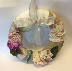 Elegant and stylish this handmade wreath is stunning lots of detailing and enhancements attached by hand to a handmade round wreath measures 15 approx circumference Totally unique only available Great Christmas gift idea for anyone who loves unique handmade goods in a vintage or shabby chic style