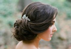 Low bridal updo with crystal hair accessory