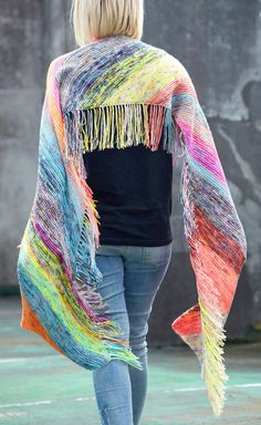 Free Knitting Pattern for Easy Flying Fringe Scarf - Great for stash yarn and mini skeins! This colorful scarf is knit in garter stitch on the bias with 2 strands of different color yarn held together to create a marled effect. Designed for mini skeins, you could easily used stash and scrap yarn instead.  And no weaving in ends – they become part of the fringe! Designed by Beata Jezek for Hedgehog Fibres. Rated very easy by Ravelrers.