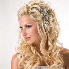 cute wedding hair-do! love with the pin on the side!