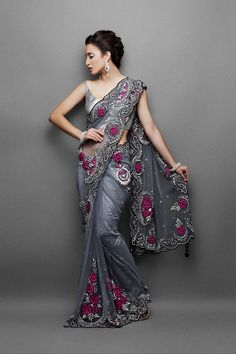 Designer sarees- Grey net sari with black cutdaana & silver crystal work