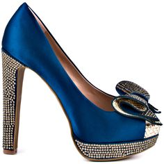 You'll want to show off all night in this glorious satin number by Vince Camuto.  A rich ocean blue fabric covers the entire silhouette and boast a rhinestone encrusted 5 inch heel and 1 1/2 inch platform.  Making the Grady style unique is a rolled bow adorned with sparkly stones and a pop of beige snake print nestled inside the curves.