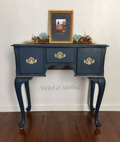 Accent table painted with Annie Sloan Chalk Paint in Napoleonic Blue/Graphite mix with gilding wax and clear wax.