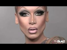 Miss Fame takes drag to a whole new level.  This really shows all the effort that transformed those manly features into a delicate woman.  Now that's what I call artistry.  Gorgeous!