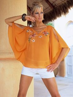 Blouse with interesting sleeves. Website in Spanish, but has good photos. This is just squares, sewed together in strategic spots.