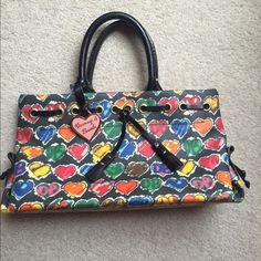 Dooney & Bourke purse This unique graffiti print Dooney & Bourke purse is perfect for a night on the town, or a casual day with the gals! This bag is in very good condition, and feels as good as new. Dooney & Bourke Bags