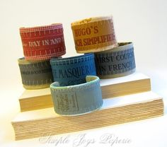cuff bracelets made from vintage French book spines by SimpleJoysPaperie (etsy)
