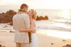 Amanda and Clem had a lovely beach wedding on the island of Maui. This cute as a button couple used Hotel Wailea as the backdrop for their first look. They held their ceremony on Paluea Beach. The weather was perfect for Amanda and Clems ceremony, with just a slight breeze to keep the wedding guests cool. The couple was even lucky enough to have the perfect sunset during their post wedding photo-shoot. Photography by Karma Hill