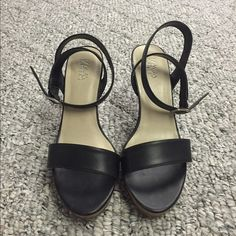 Black strappy sandal Kaya purchased at journeys. Black, wrap around ankle strappy sandal. Cork sole. 4 inch heel. Size 7.5. Clean smokefree home only worn a few times. Excellent condition. Kaya Shoes Sandals