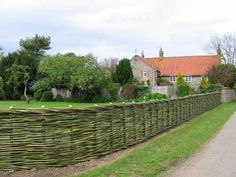 Willow fencing - wonder how long it takes to build such a long fence.  Can you add as you go?  Build so far one year, continue the next? This link has a number of great wattle fencing images.  Want to employ this.
