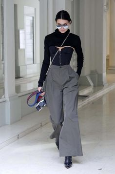Kendall Jenner wearing Asahi Pentax Vintage K1000 Camera, Givenchy Bow-Cut Mini Leather Crossbody Bag, Gentle Monster x Opening Ceremony Zhora 02 Sunglasses, Givenchy Ankle Boots in Studded and Woven Stretch-Leather, Zaid Affas Fall 2016 Cropped High Neck Knit Top and Erika Cavallini Fall 2016 High Waisted Pants