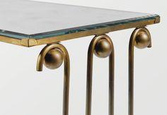 Jean Royère GUÉRIDON ONDULATION, VERS 1950 'ONDULATION', A GILT METAL AND MIRRORED GLASS OCCASIONAL TABLE BY JEAN ROYÈRE, CIRCA 1950 métal doré, piétement ondulé à boules hautes et basses reliées par une entetoise, plateau en miroir Hauteur : 50 cm (19 3/4 in.) Largeur : 51 cm (20 in.) Profondeur : 34,5 cm (13 1/2 in.)