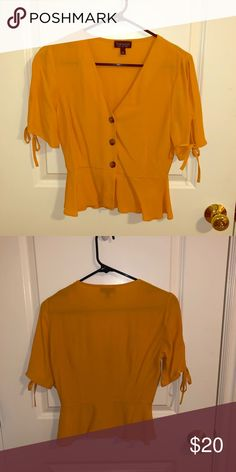 3669dc70ef15d Yellow TopShop Peplum Blouse This is a lovely little peplum blouse from  TopShop