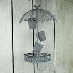 Pretty present for Mum. Unusual metal umbrella planter with room for 3 small trailing plants. http://www.thesatchvillegiftcompany.co.uk/products/new-for-autumn-2015