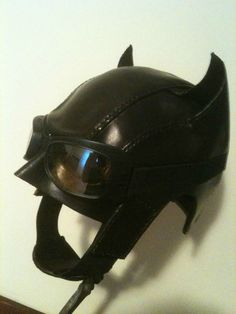 Technique for making leather shaped to fit an object. This is a mask made custom to fit one person's head.