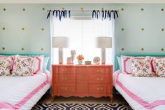 A beautiful coral dresser separates the twin beds in this shared girls' bedroom. The light aqua accent wall and sunburst pattern bring life and light to the design. Aqua Bedrooms, Shared Bedrooms, Teen Girl Bedrooms, Little Girl Rooms, Coral Colour Palette, Coral Color, Color Palettes, Teal Coral, Turquoise Accents
