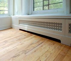 Been looking for a solution to our very ugly baseboard heater covers and haven't seen anything that I find attractive. Hydronic Baseboard Heaters, Electric Baseboard Heaters, Baseboard Heating, Baseboard Radiator, Baseboard Heater Covers, Radiator Heater, Hopkins Homes, Floor Heater, Decorative Radiators